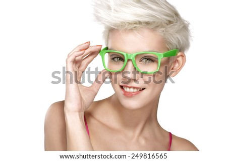 pretty young blond model wearing cool eyeglasses on white - stock photo