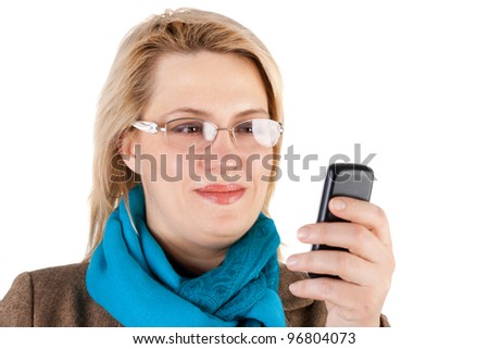 pretty young blond smiling woman with the mobile phone - stock photo