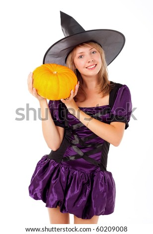 pretty young blond woman dressed as a fairy with a pumpkin - stock photo