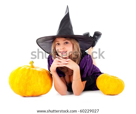 pretty young blond woman dressed as a fairy with pumpkins - stock photo