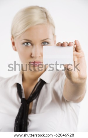 pretty young blond woman in white shirt and scarf like a tie showing a white card.FOCUS ON THE CARD