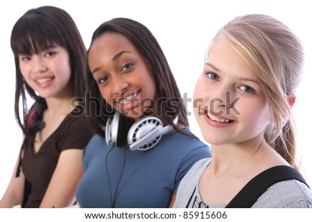 Pretty young blonde caucasian student girl with two other multi ethnic teenage friends, an oriental Japanese and African American mixed race girl, all with happy smiles. - stock photo