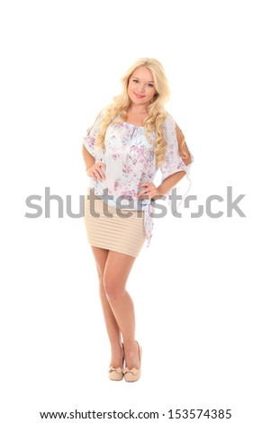 Pretty young blonde in a light summer blouse - stock photo
