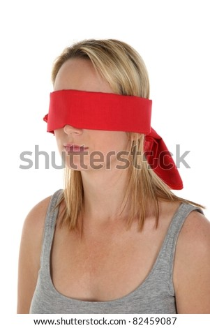 Pretty young blonde lady with a red blindfold over her eyes