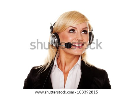 Pretty young blonde with headphones and office clothing - stock photo