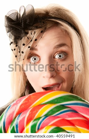 Pretty young blonde woman with large colorful lollipop