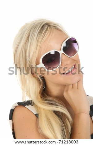 Pretty young blonde woman with large white sunglasses - stock photo