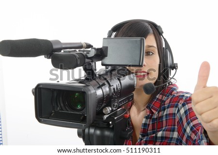 pretty young brunette girl with a professional camcorder, isolated on white background