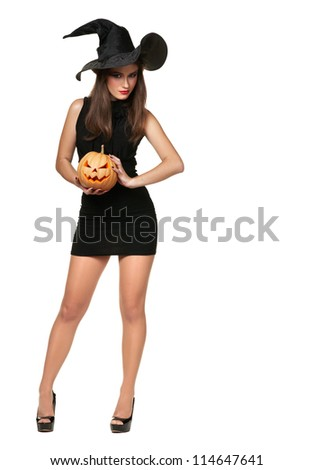 pretty young brunette woman dressed as a fairy with a pumpkin - stock photo