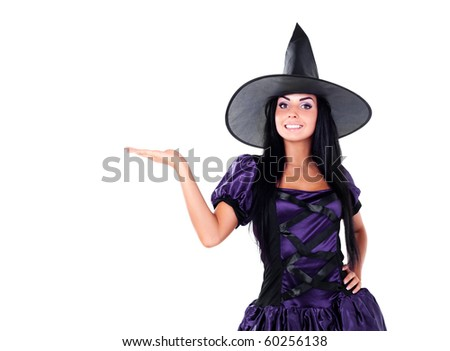 pretty young brunette woman dressed as a fairy with her hand up, place your product here - stock photo