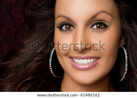 Pretty young brunette woman smiling - stock photo