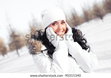 pretty young brunette woman wearing warm winter clothes outdoor - stock photo