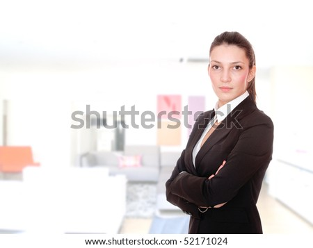 pretty young business woman in interior