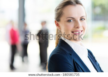 pretty young business woman in modern office