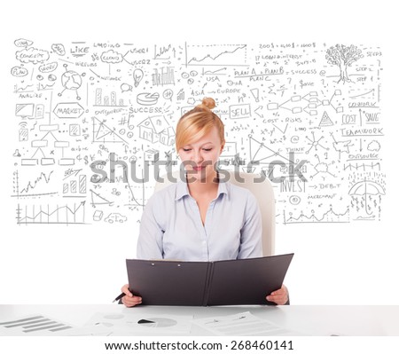 Pretty young businesswoman planning and calculating various business ideas - stock photo