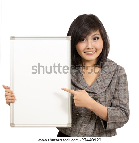 pretty young businesswoman showing blank whiteboard - stock photo