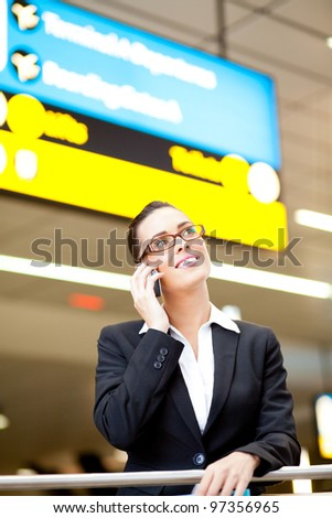pretty young businesswoman talking on cell phone