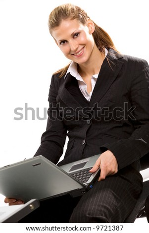 Pretty young businesswoman working with laptop computer - stock photo