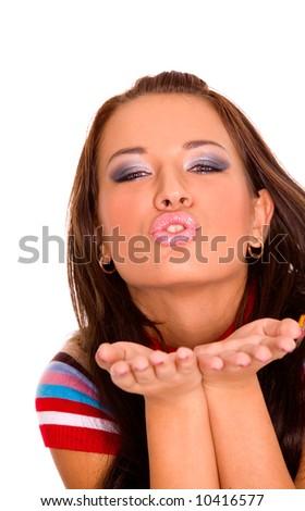 Pretty young caucasian girl sending kiss - stock photo