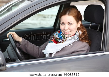 Pretty young Caucasian woman driving a car
