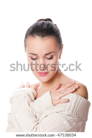 pretty young caucasian woman with eyes closed wearing a white sweater - stock photo