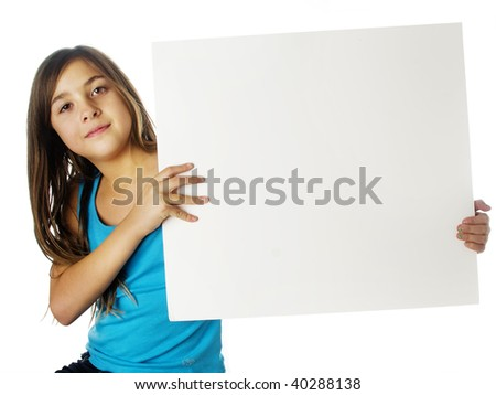Pretty young child holding a blank sign board - stock photo
