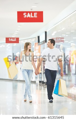 Pretty young couple makes purchases in the store - stock photo