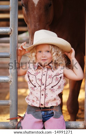 Pretty young cowgirl. - stock photo