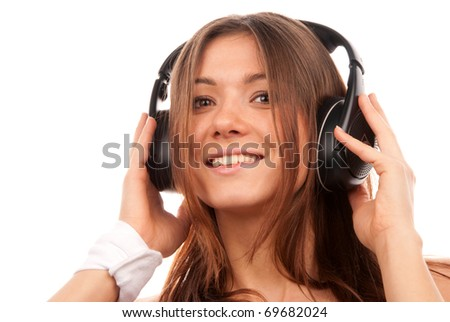 Pretty young DJ woman listening music in big headphones on mp3 player smiling and laughing isolated on white background - stock photo