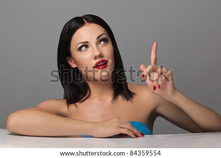 pretty young excited woman, against grey background - stock photo