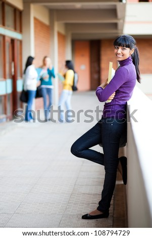 pretty young female college student full length portrait - stock photo