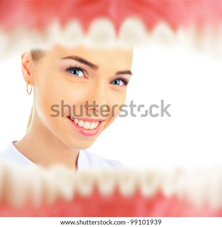 Pretty young female dentist looking inside patient`s mouth view from inside - stock photo
