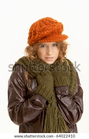 Pretty young female dressed up warm for autumn, freezing.? - stock photo