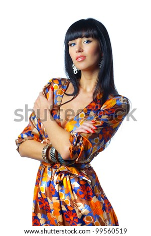 Pretty young female in orange top isolated against white - stock photo