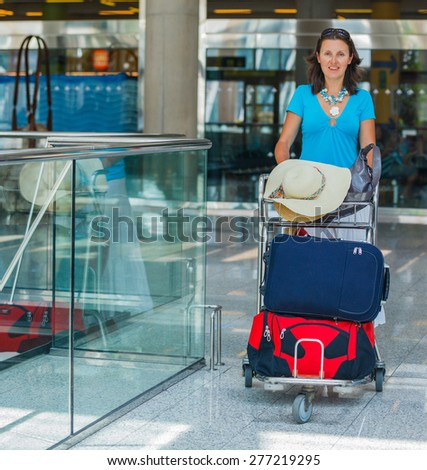 Pretty young female passenger at the airport - stock photo