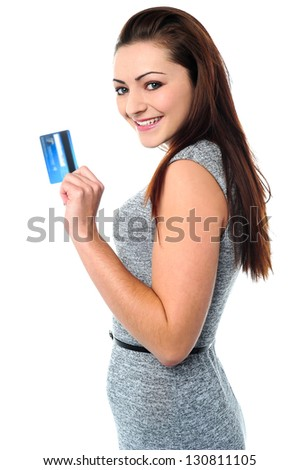 Pretty young female showcasing her cash card.