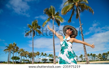 Pretty young female soaking in the sun with her arms raised on Hawaiian beach. Happiness bliss freedom concept, summer holidays travel.  - stock photo