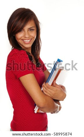 Pretty young female student with bright confident smile holding books.  Isolated against white background. - stock photo