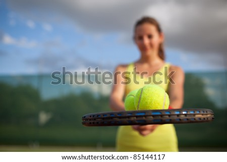 pretty, young female tennis player on the tennis court (shallow DOF, selective focus) - stock photo