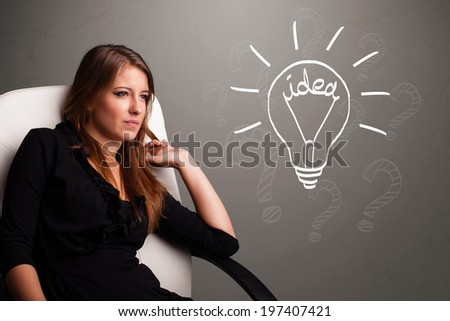 Pretty young girl coming up with a light bulb idea sign