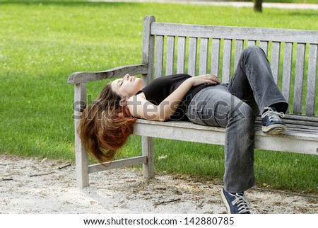 pretty young girl couch on a bench