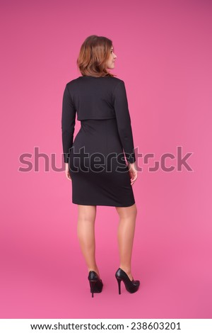 pretty young girl demonstrating a costume, back view - stock photo