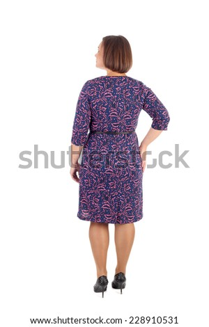 pretty young girl demonstrating a dress, back view - stock photo