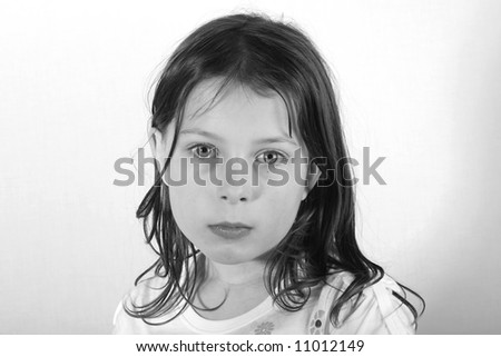 Pretty Young Girl Head Shot against a Light Background - stock photo