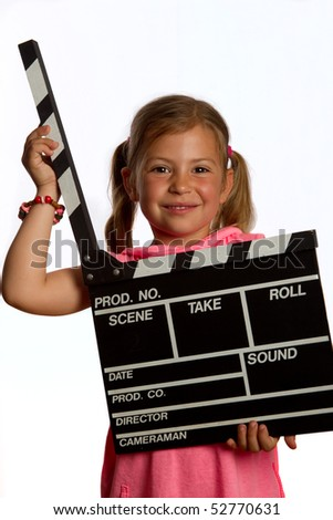 Pretty young girl holding a clapperboard in the open position