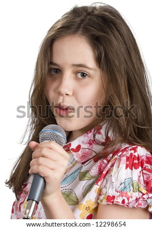 Pretty young girl holding a microphone and singing