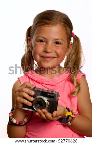 Pretty young girl holding an old camera