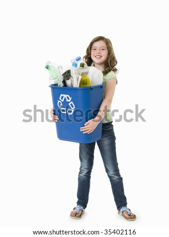 Pretty young girl holding blue recycle bin on white background - stock photo