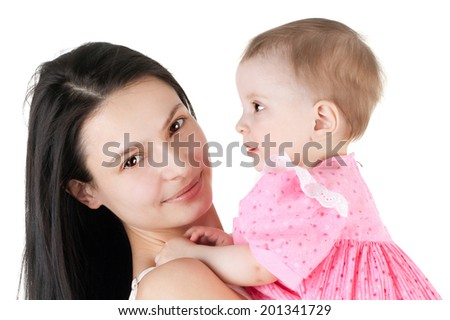 pretty young girl holding cute little baby - stock photo