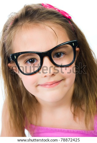 Pretty young girl in glasses against isolated white background - stock photo